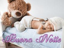 Buona notte - bimbo che dorme con l'orsacchiotto